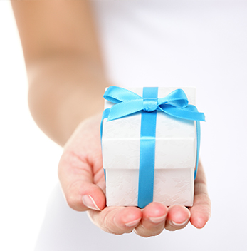 Hand with gift box in palm