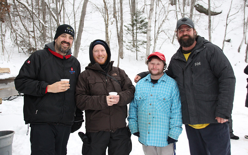 A group of volunteers standing together outside on a winter day