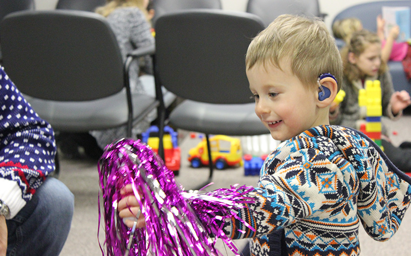 Young boy wearing hearing aid